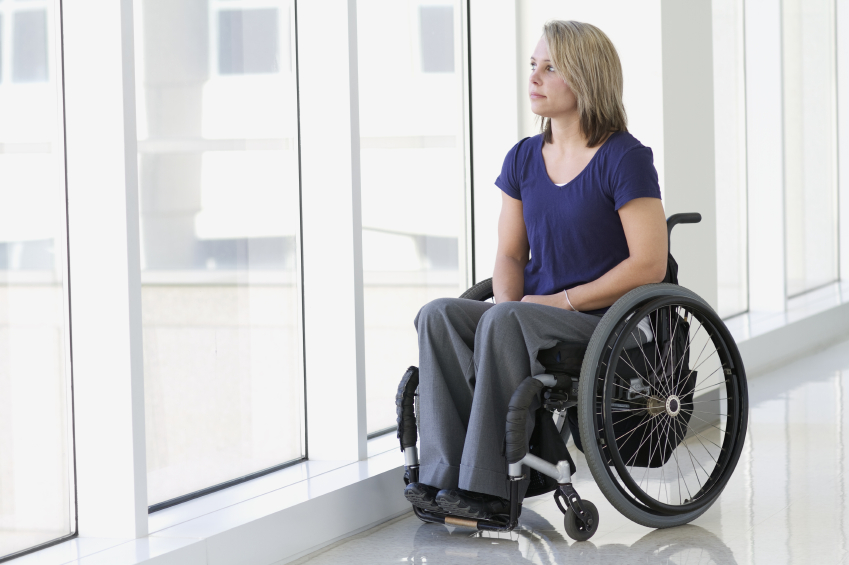 Disabled-woman-looking-out-window