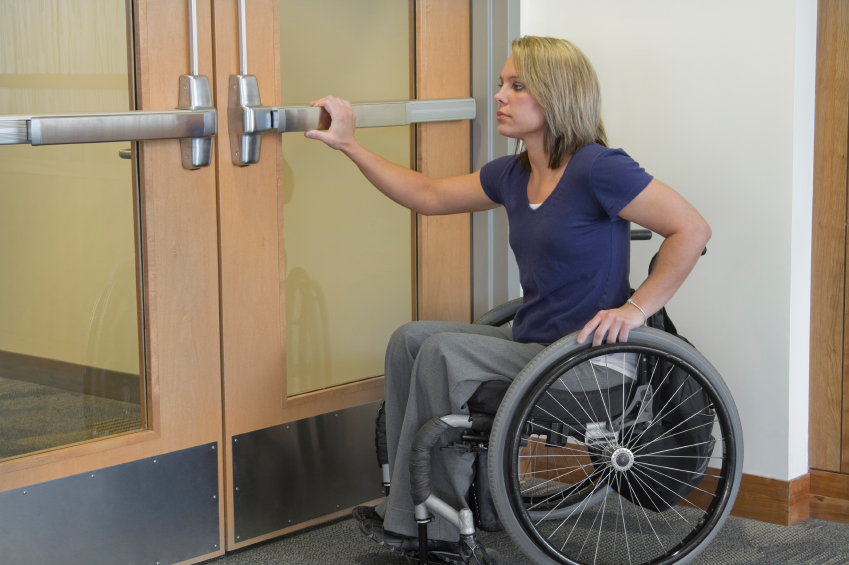 Woman-Disabled-opening-door