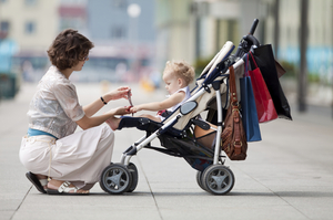 Woman-with-Child-Stroller-thumb-300x199-9150